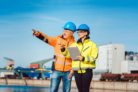 Workers in a commercial river port having a work meeting