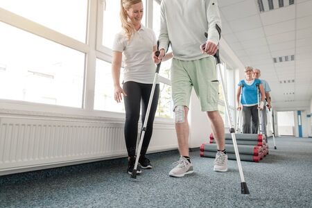 People in rehabilitation learning how to walk with crutches after having had an injury