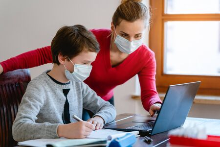 Mother and son in video chat with school teacher wearing masks