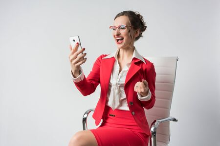 Businesswoman having great success just getting message on the phone Standard-Bild