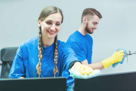 Man and woman team of commercial cleaners working diligently