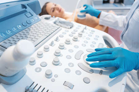 Woman patient having ultrasound scan on modern machine to prevent cancer Stock Photo