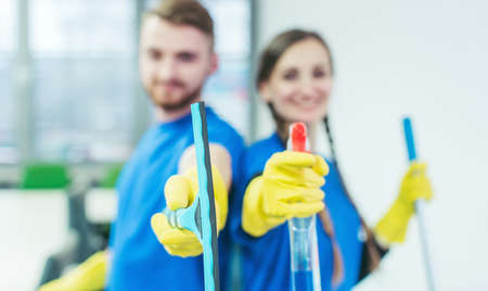 Commercial cleaner team, focus on the gear in their hands Zdjęcie Seryjne