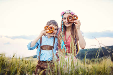 Mother and son in Bavaria looking through pretzels