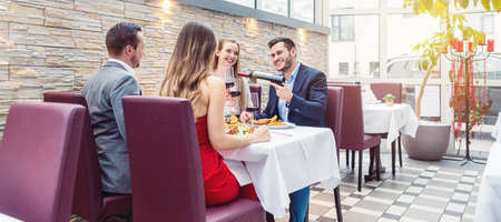People in a fancy Restaurant eating