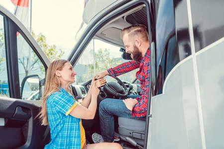 Man and woman testing a camper van or RV