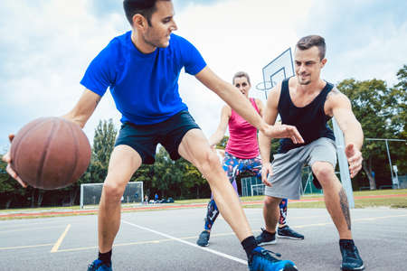 Basketball players practicing game at outdoor