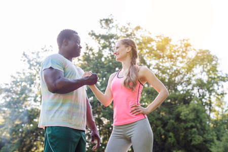 Black-white couple getting some motivation for sport exercise