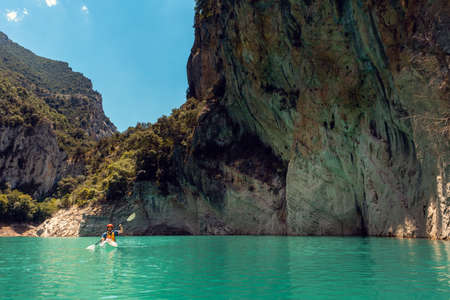 Man on a kayak on the waters of the Mont Rebei Gorge in Catalonia 写真素材