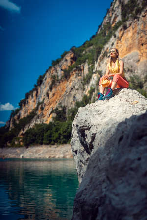 Woman sitting on rocks above the Mont Rebei Gorge in Catalonia