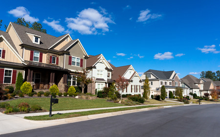 house siding: Street of large suburban homes