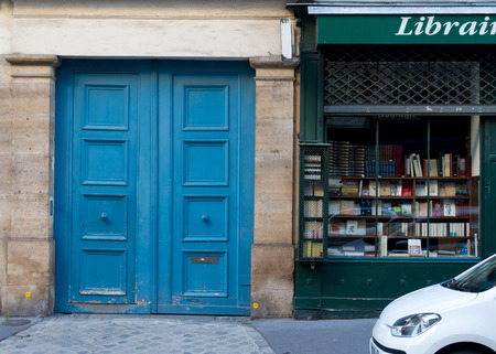 Wooden arch entry door and book store front - Paris, France