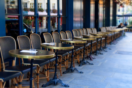 Street cafe terrace with tables and chairs, Paris France