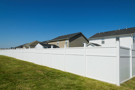 white picket fence: Suburban landscape with a long vinyl fence