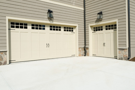car garage: Residential house three car garage doors