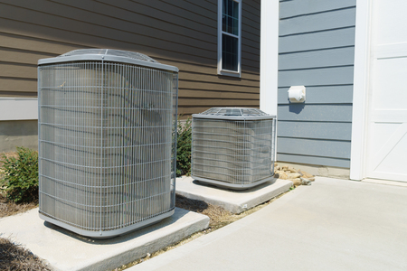 AC unit attached to residential house