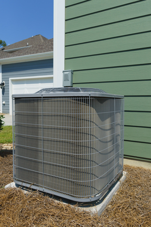 A/C unit attached to residential house