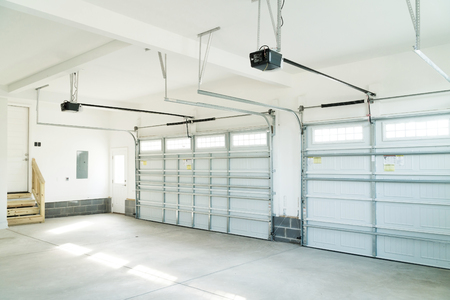 Large three car garage interior Stock Photo