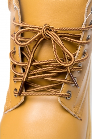 laces on the brown boots Stock Photo - 17616590