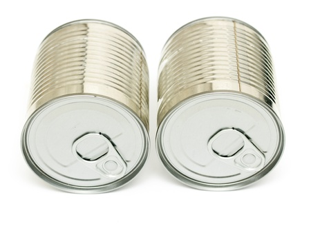 sealed metal cans isolated on white background photo