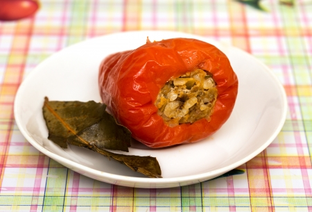 red peppers stuffed with meat on the plate photo