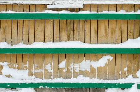 background wooden fence in the snow photo