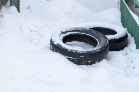 old rubber tires in the snow Stock Photo - 17771012