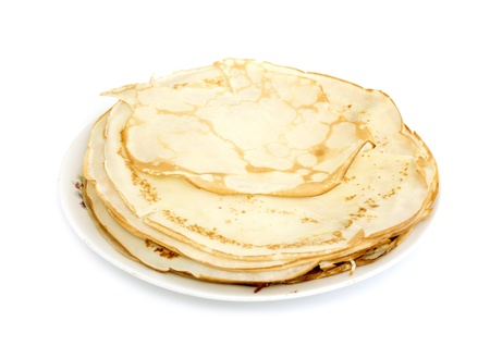 pancake week: a lot of pancakes on a plate isolated on white background