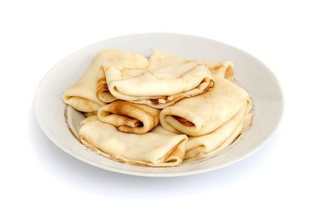 a lot of pancakes on a plate isolated on white background Stock Photo - 18201513