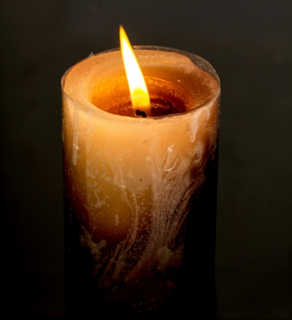 flame of a candle on a black background photo