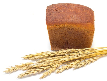 bread and wheat ears on a white background photo