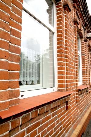 window in the house of red brick photo