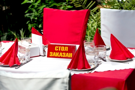 table setting, with a sign table is busy photo