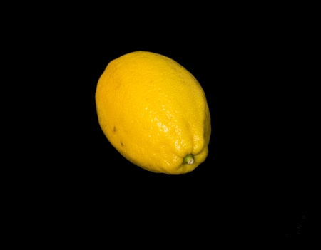 lemon on a black background photo