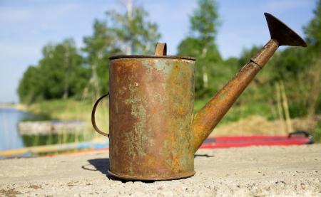 metal watering old photo