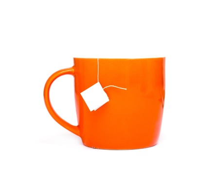 mug with a sachet of tea on a white background photo
