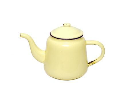 yellow teapot isolated on white background photo