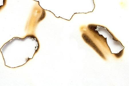 Fire holes in white paper Stock Photo - 18931973