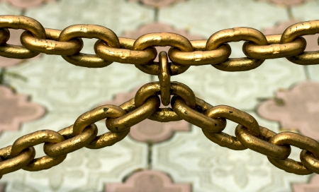 chain fence: metal chain fence, gold Stock Photo