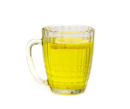 big mug with lemon tea on a white background photo
