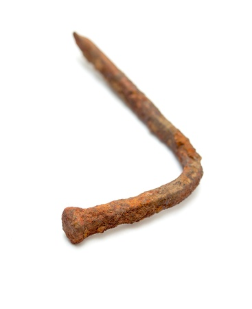rusty nail isolated on white background photo
