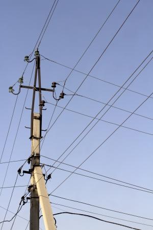 isolator insulator: electric pole in the trees Stock Photo