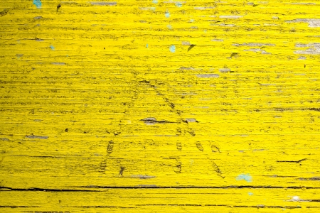 old wood texture traces of yellow paint photo