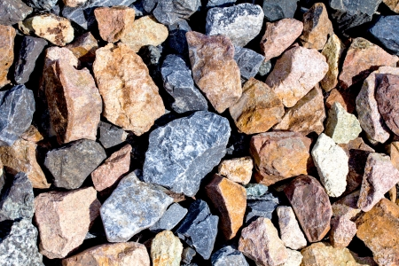 Rail road track ballast stone gravel close-up as background photo
