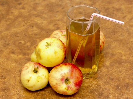 ripe apples and glass of juice photo