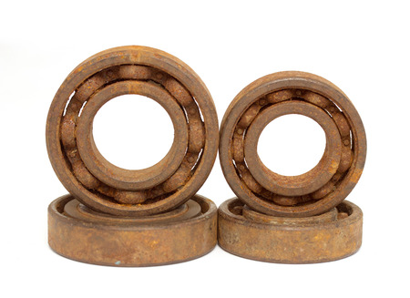 Old and rusty ball bearing, isolated on white background photo