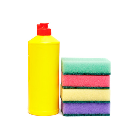 household tasks: sponge for washing dishes and a bottle of liquid