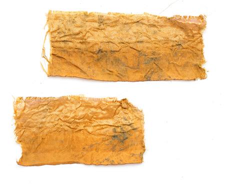 tissu or: un morceau de tissu d'or sur un fond blanc Banque d'images