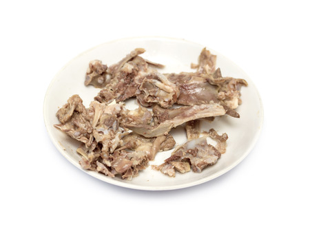 leavings: picked chicken bones on plate with white background