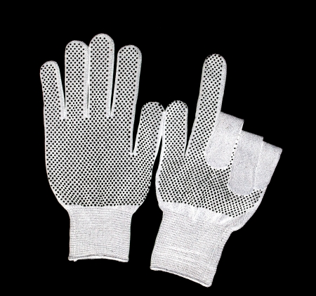manual test equipment: white workers glove isolated on a black background.